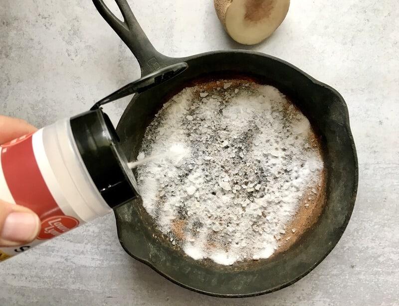 salt in bottom of rusty cast iron skillet