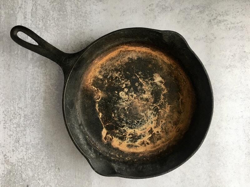 rusty cast iron skillet