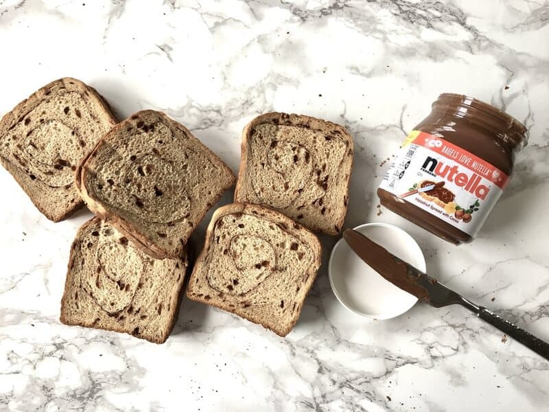 container of nutella with cinnamon bread slices