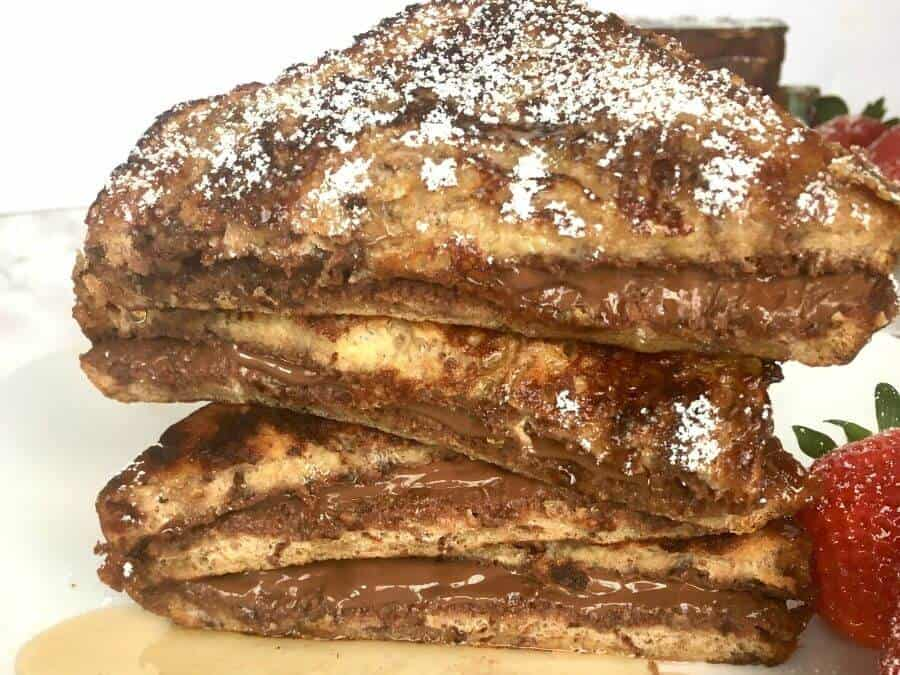 Nutella french toast stacked up on a plate
