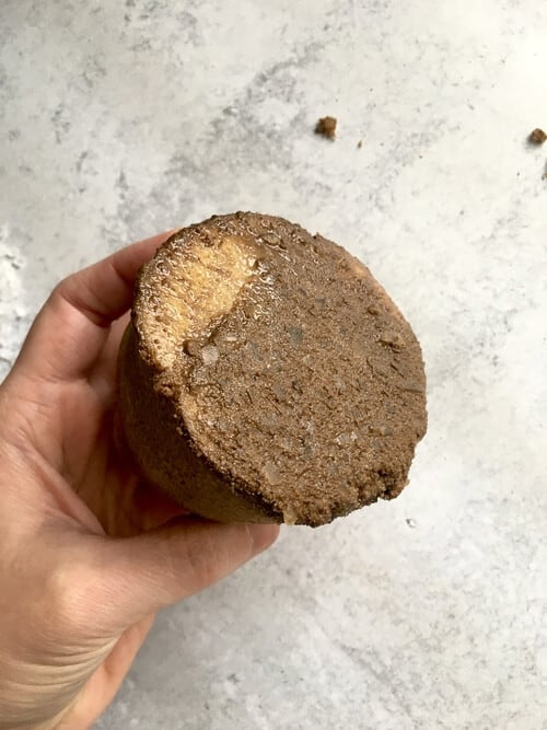 cut potato with brown mud looking substance on it