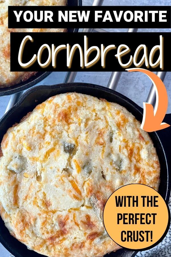 cornbread in a cast iron skillet with cheese and green chiles