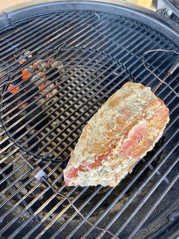 eye of round roast smoking on the grill